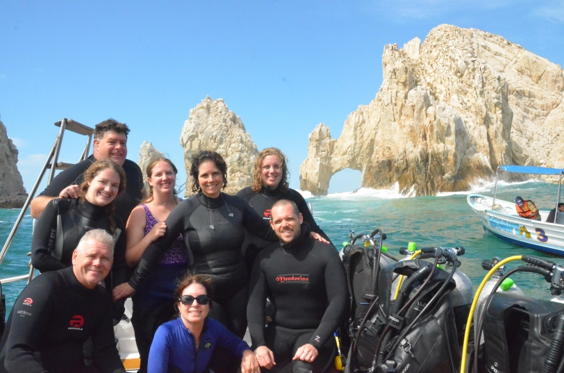 Our diving family: my Dad, stepmom, brother, husband, two SIL, and daughter.