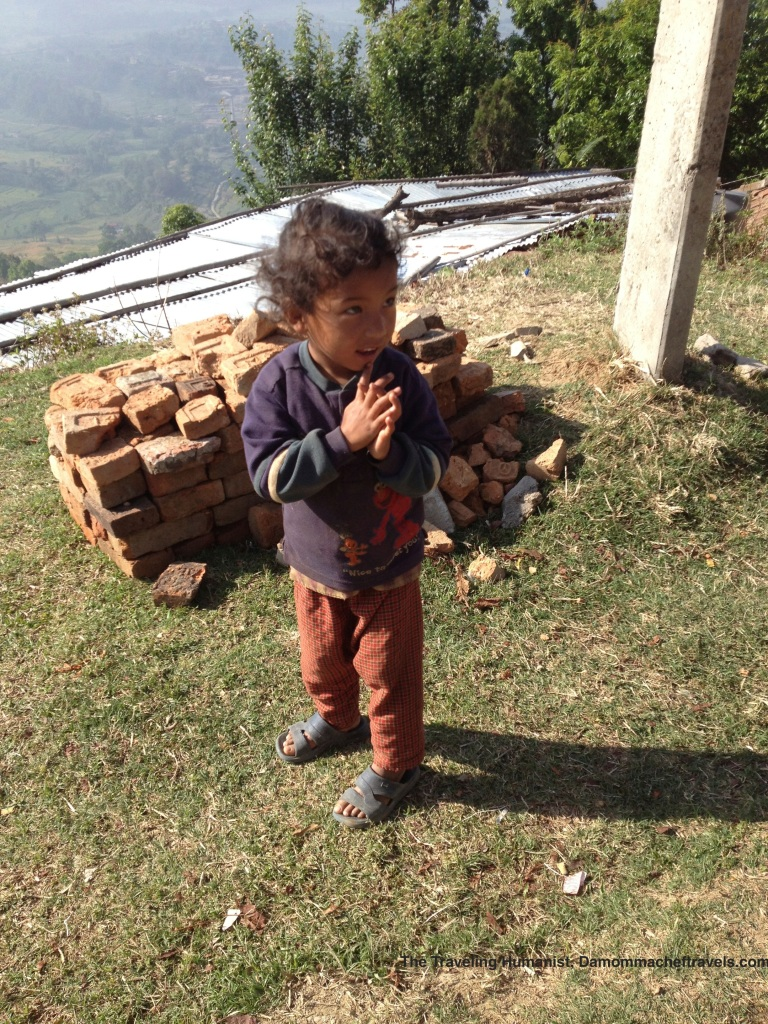 Tiny little girl by the side of a hiking trail in Nepal.