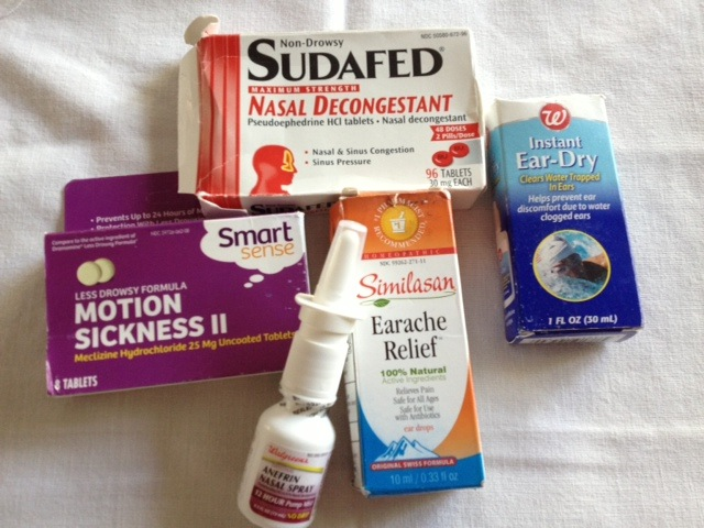 "Here is my ""ear care"" scuba kit: Sudafed, Ear dry, 12 hour nose spray, all-natural ear pain drops for slight discomfort."