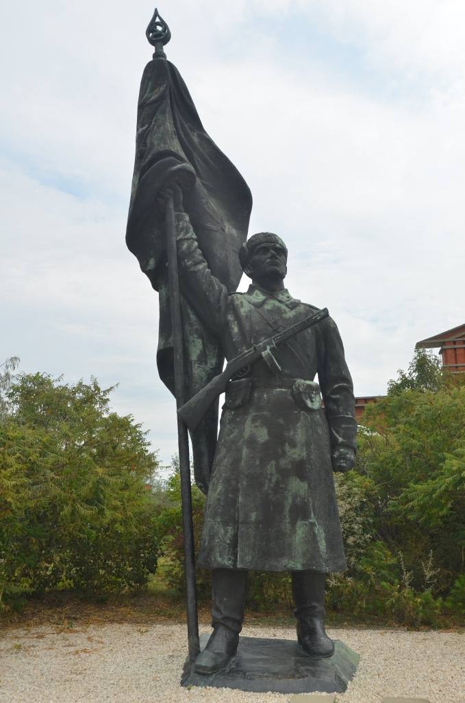 Here is the missing soldier, now standing at attention at Memento Park.  The Hungarians felt the automatic weapon strapped across his body was grossly incongruous with the other statuary.